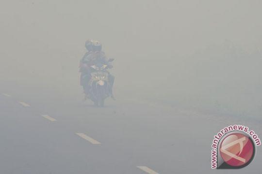 Hari Sumpah Pemuda diwarnai demo kabut asap