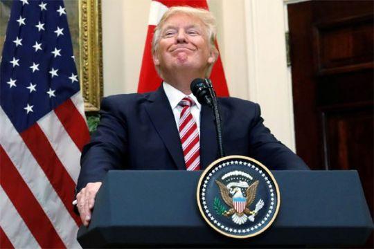 """Trump katakan """"sesuatu bisa terjadi"""" soal perjanjian iklim Paris"""