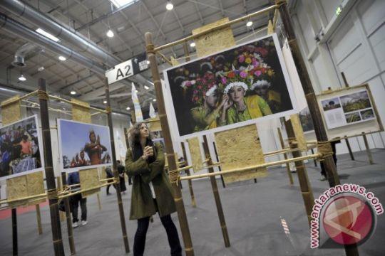 Berita menarik kemarin, pameran foto Indonesia di Jerman hingga mental juara Liliyana Natsir