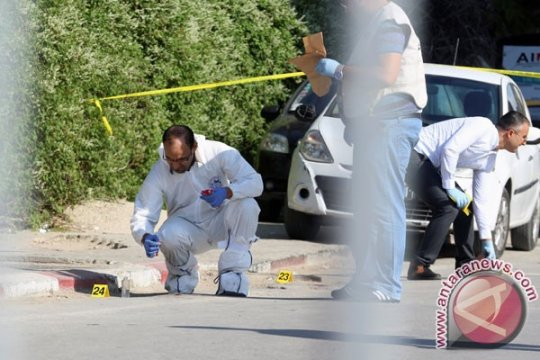 Wanita terlibat bom bunuh diri di Tunisia , sembilan luka-luka