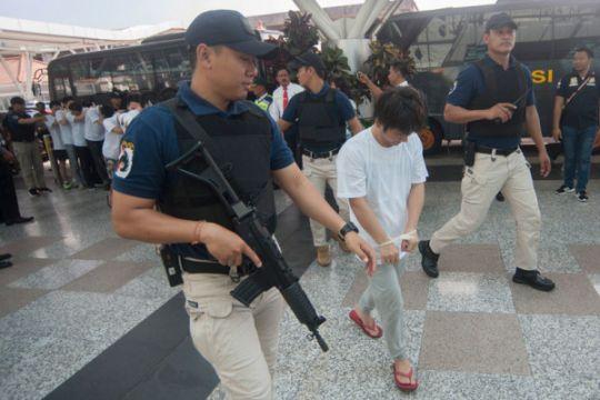 105 tersangka penipuan yang diusir Indonesia tiba di China