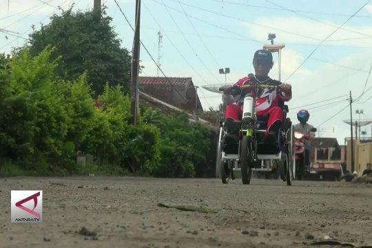 Motor penarik kursi roda