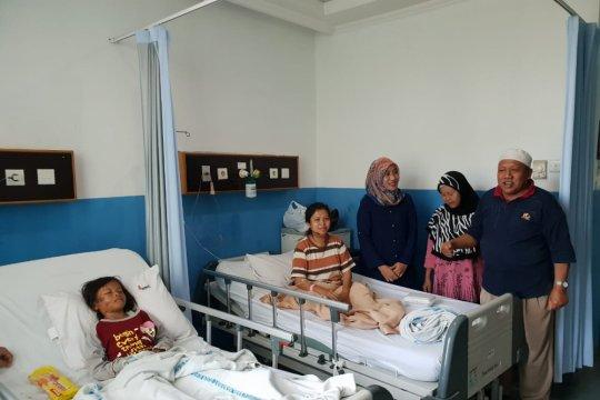 Empat anak korban tsunami telah berkumpul dengan keluarga