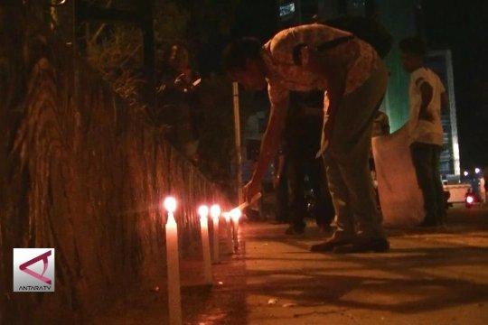 Aksi Bakar Lilin untuk korban penembakan Nduga