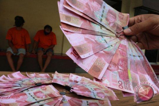 Warga Paninjauan tangkap pengedar uang palsu