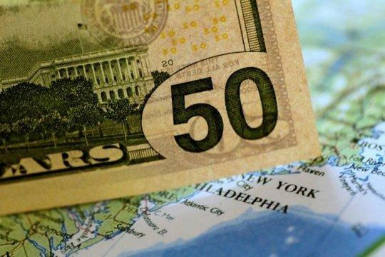 Dolar melemah setelah pelaku pasar cerna laporan Federal Reserve