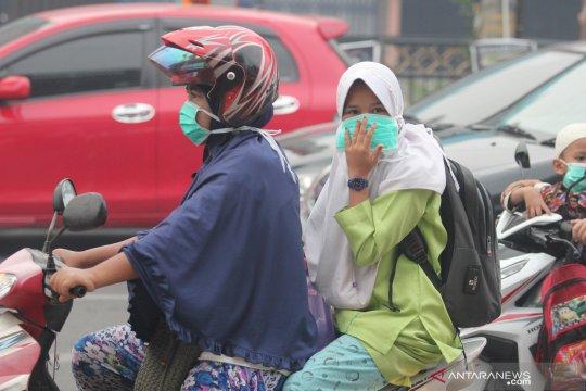 Pakai masker untuk hindari asap