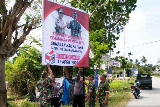 Polres Aceh Utara Sebarkan Spanduk Ajak Warga Gunakan Hak Pilih