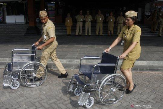 Bantuan kursi roda untuk pensiunan ASN