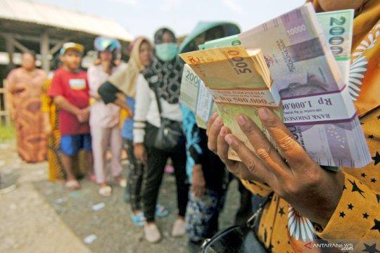 Penukaran uang baru di TPI Tegal