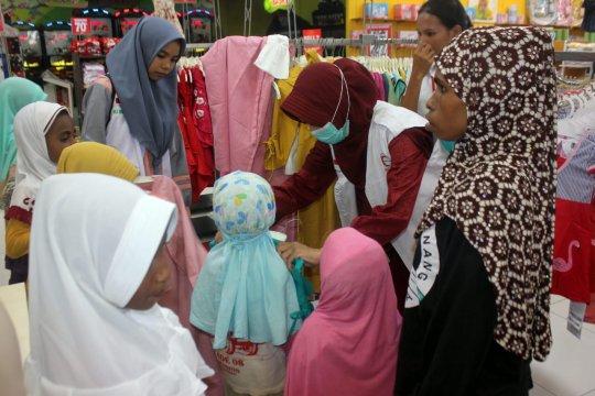 BSMI belikan anak Muslim Papua baju Lebaran