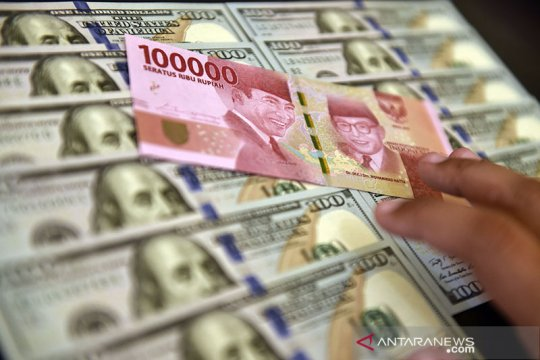 Rupiah menguat seiring sinyal pelonggaran moneter bank sentral AS