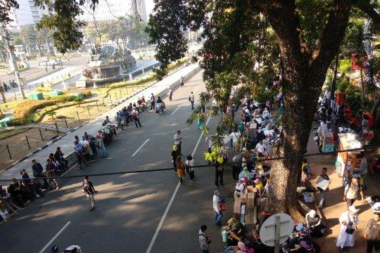 Massa mulai berkumpul di kawasan Patung Kuda