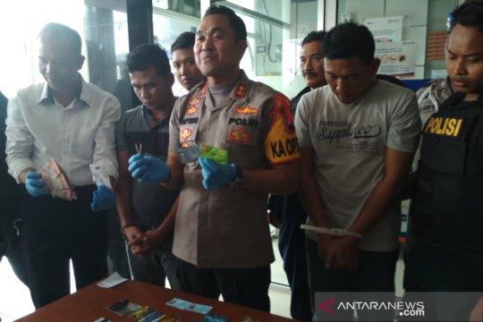 Dua pembobol ATM modus ganjal dengan batang korek ditangkap