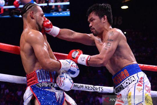 Manny Pacquiao tundukkan Keith Thurman