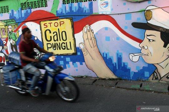 Mural imbauan stop calo pungli