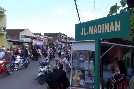 Keharmonisan nan indah di Kampung Madinah