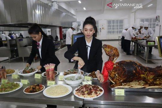 Peserta pelatihan kamp vokasi Xinjiang pulang pascakelulusan