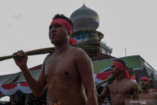 Tradisi Pukul Sapu negeri Mamala Page 4 Small