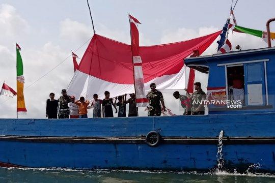 Pawai bendera merah putih di perbatasan perairan Indonesia-Malaysia