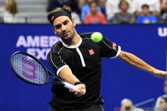 Kalahkan Evans, Federer mulus ke babak empat
