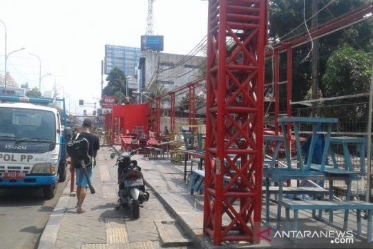Pemindahan penjual nasi kapau Jalan Kramat Raya tertunda