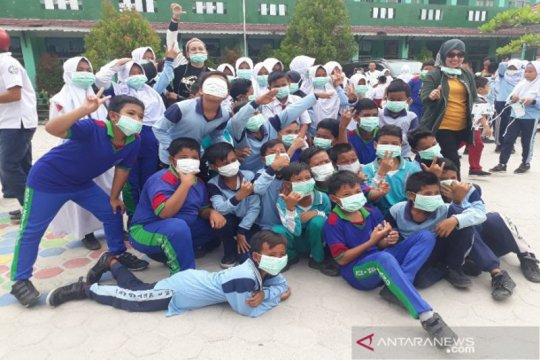 DPRD dan PWI Kotawaringin Timur bagikan 2.000 masker