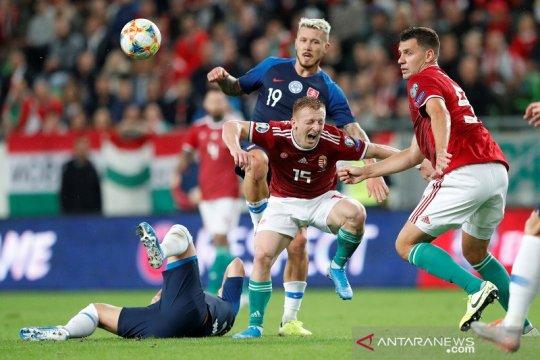 Pendukungnya rasis, UEFA hukum Hongaria dan Slovakia
