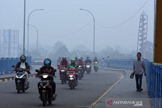 Kabut asap Karhutla kian pekat, jarak pandang di Riau hanya 200 meter