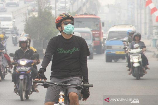 Minggu pagi, kabut asap di Banjarmasin masih pekat