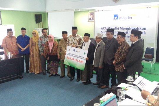 Unit syariah AXA Mandiri salurkan dana surplus underwriting