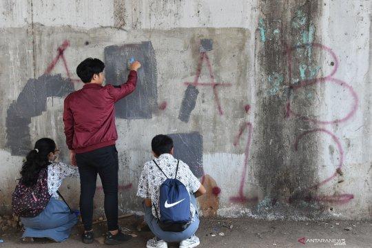 Aksi tutup coretan vandalisme