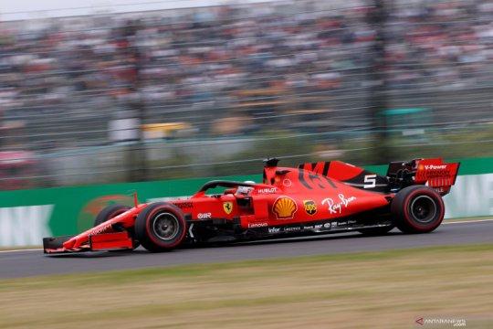 Vettel rebut pole  position GP Jepang, dua Ferrari start terdepan