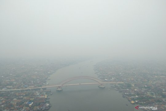 Palembang masih diselimuti kabut asap