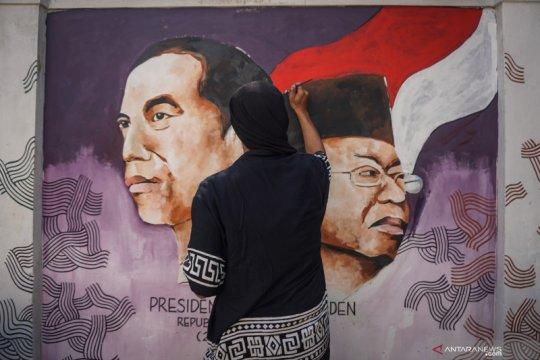 Melukis mural presiden dan wapres terpilih