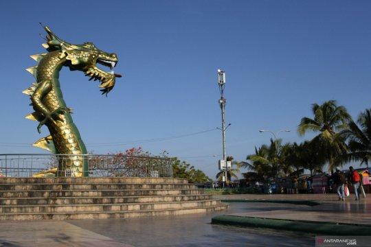 Patung kepala naga kerajaan Kesultanan Buton