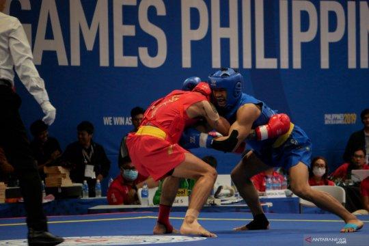 Wushu sanda tambah tiga perak untuk Indonesia