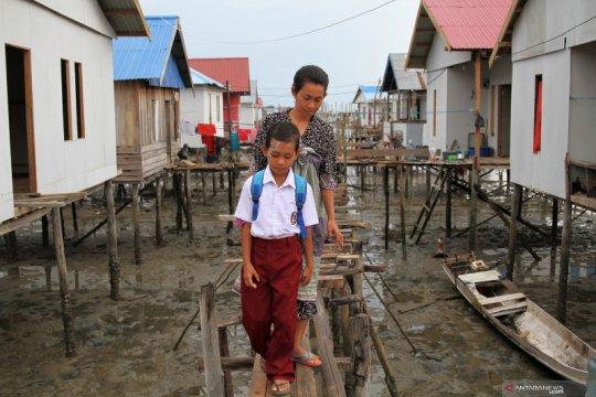 Warga Suku Bajo nikmati program renovasi rumah