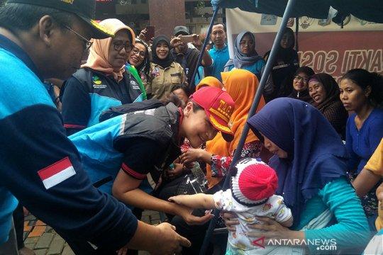 Istri Mensos bantu pulihkan trauma korban banjir di Rawa Buaya