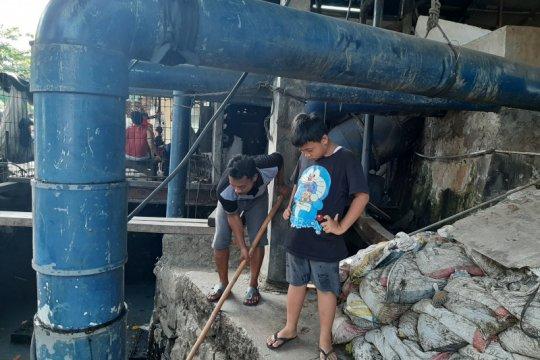 Kisah para penjaga rumah pompa Muara Karang terjaga bersama hujan