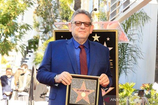 CEO Universal Music Lucian Grainge positif corona
