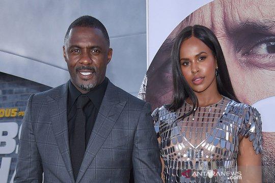 Istri Idris Elba positif corona gara-gara selalu dampingi suami