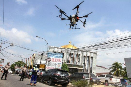 Penyemprotan disinfekatan menggunakan drone
