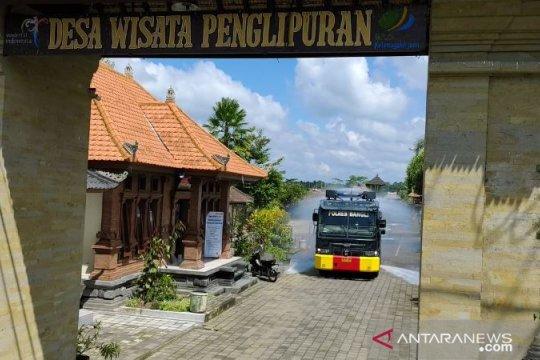 Desa wisata Penglipuran Bali disemprot disinfektan