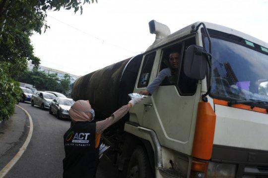 ACT Jawa Timur bagikan masker kain untuk masyarakat Surabaya