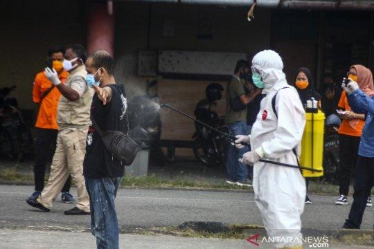 Gelombang ketiga TKI dari Malaysia tiba di Medan