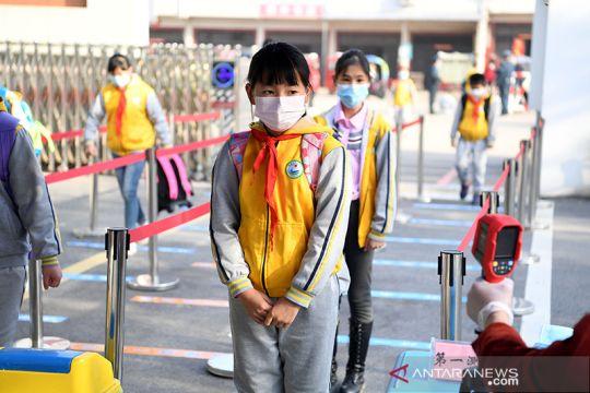 Di Zipeng sejumlah anak kembali ke sekolah