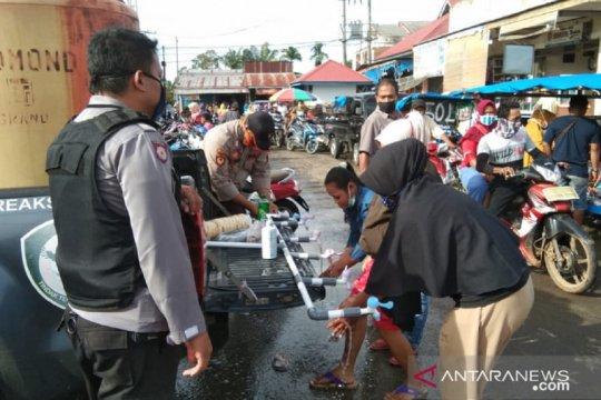 Polisi gencarkan sosialisasi cegah COVID-19 di pasar tradisional