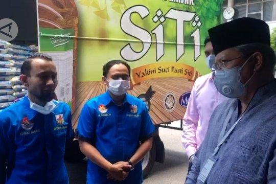 Sumbangan 1000 paket beras untuk TKI di Malaysia