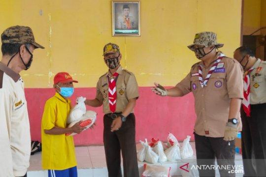 Kwarcab Pramuka OKU salurkan bantuan 100 paket sembako